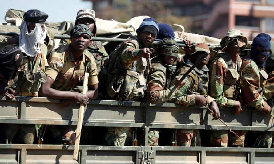 Soldiers patrol the streets of Harare on Thursday.
