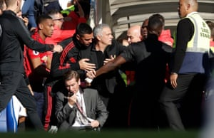 October 20: Jose Mourinho has to be restrained during a tunnel fracas after a late Chelsea equaliser at Stamford Bridge.