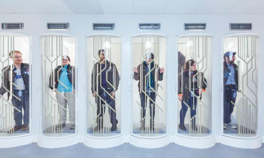 Contestants locked-in to pods as part of the Crystal Maze interactive game in London.