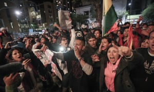 Supporters of the Bolivian opposition candidate Carlos Mesa of Comunidad Ciudadana party prepare to burn ballots during a protest in La Paz, Bolivia on Monday.