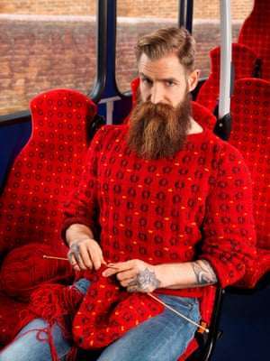 Man knitting on a bus