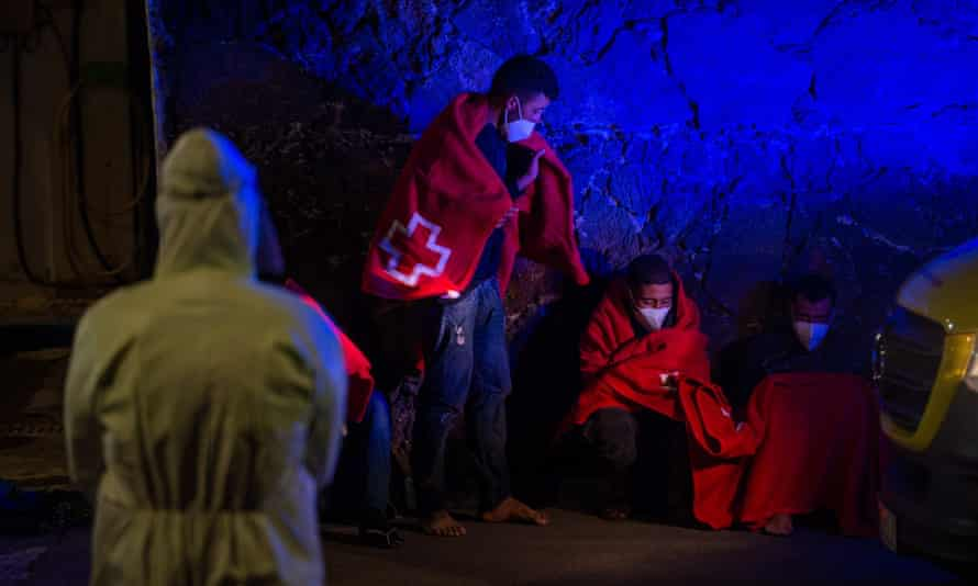 Three men recover in Arrieta on Lanzarote last month after being rescued from a small boat.