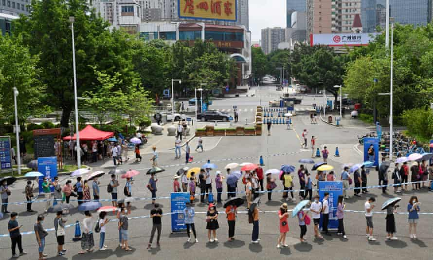 People queue to receive the Covid-19 vaccine in Guangzhou in Guangdong province, China.