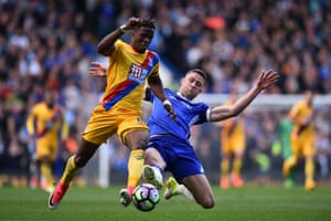 Crystal Palace's Wilfried Zaha evades a tackle from Chelsea's Gary Cahill
