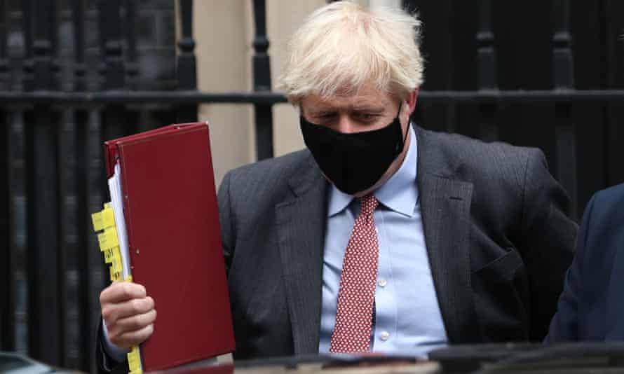 Boris Johnson leaves 10 Downing Street to attend Prime Minister's Questions, at the Houses of Parliament, London, in September 2020