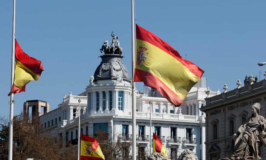 Spanish flags at half mast.