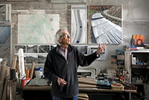 Christo in his studio with a preparatory collage for Over the River, 2011.