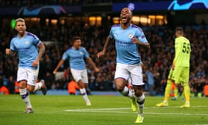 Raheem Sterling of Manchester City celebrates after scoring the opening goal.