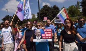 "Democratic Union supporters protest against Netanyahu outside the Knesset: ""We won't allow the forger to steal the election."""