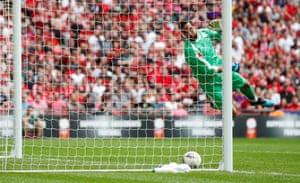 Bravo watches as Van Dijk's shot lands on the goal line.