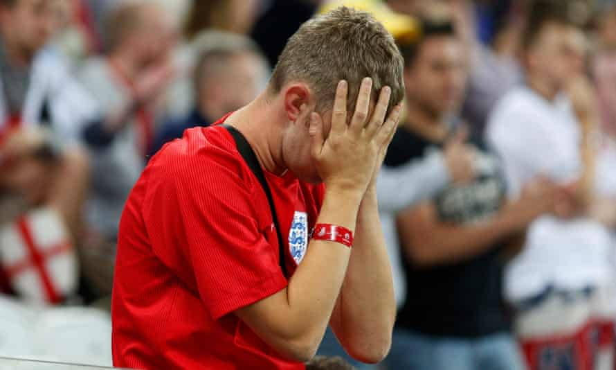 An England fan reacts to the 2-1 defeat against Uruguay that all but doomed the side's chances at the 2014 World Cup
