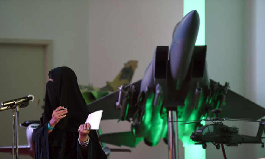 A Saudi journalist asks questions next to a replica of a Saudi fighter jet during a briefing on Operation Decisive Storm, the Saudi-led coalition carrying out air strikes against Houthi militia