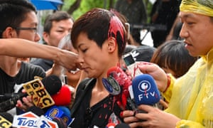 Denise Ho has red liquid thrown at her during a media appearance outside parliament in Taipei on Sunday.