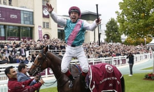 Frankie Dettori does a flying dismount from Enable after their first Arc victory at Chantilly in 2017.