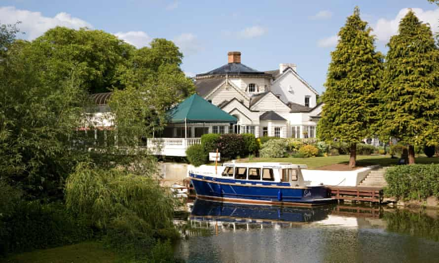 A view across the Thames to the hotel on Monkey Island, near Bray, Berkshire.