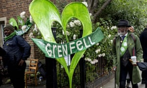 Members of the public arrive for a Grenfell Tower remembrance service at St Helen's church, Kensington, west London.