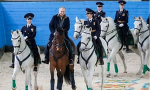 Vladimir Putin celebrates International Women's Day in Russia by riding horseback with some female police officers