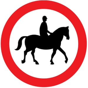 """""""Road sign from the driving theory test showing a person riding a horse in a red circle"""""""