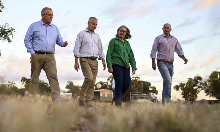 Scott Morrison and Michael McCormack speak to farmer Jacqueline Curley during a visit to Gipsy Plains Station near Cloncurry