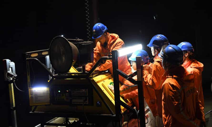 Rescuers adjust an emergency generator at the Diaoshuidong coal mine, with efforts under way to reach five others still trapped underground.