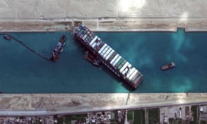 """TOPSHOT-EGYPT-SHIPPING-SUEZ<br>TOPSHOT - This satellite imagery released by Maxar Technologies shows the MV Ever Given container ship in the Suez Canal on the morning of March 28, 2021. - Hope rose on March 28, 2021 that salvage efforts would free a mammoth container ship blocking the Suez Canal for six days, crippling international trade and causing multi-million-dollar losses. The MarineTraffic and VesselFinder applications said two tugboats were heading to the vital waterway to bolster the salvage operation, while experts pinned hope on a high tide to help refloat the vessel. (Photo by - / Satellite image ©2021 Maxar Technologies / AFP) / RESTRICTED TO EDITORIAL USE - MANDATORY CREDIT """"AFP PHOTO / Satellite image ©2021 Maxar Technologies"""" - NO MARKETING - NO ADVERTISING CAMPAIGNS - DISTRIBUTED AS A SERVICE TO CLIENTS (Photo by -/Satellite image ©2021 Maxar Tech/AFP via Getty Images)"""