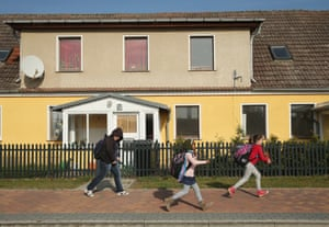 Refugee children return from school