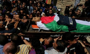 The Palestinian journalist Yasser Murtaja, shot while filming Israeli forces and a Palestinian protest, is carried to his burial on Saturday.