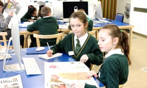 Pupils plan their stories in a newspaper front page workshop