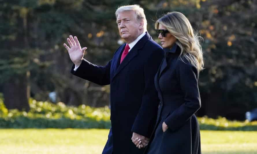 Donald Trump and Melania walk to board Marine One on the South Lawn of the White House on Wednesday to travel to Florida for the festive break.