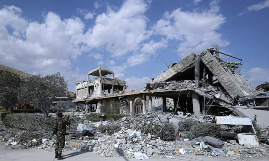 A Syrian soldier films the remains of the scientific research centre near Damascus that was destroyed by US, British and French military strikes.