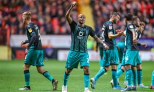 Swansea City forward André Ayew celebrates after scoring what turned out to be the winner at Charlton.