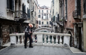A gondolier without customers in Venice.