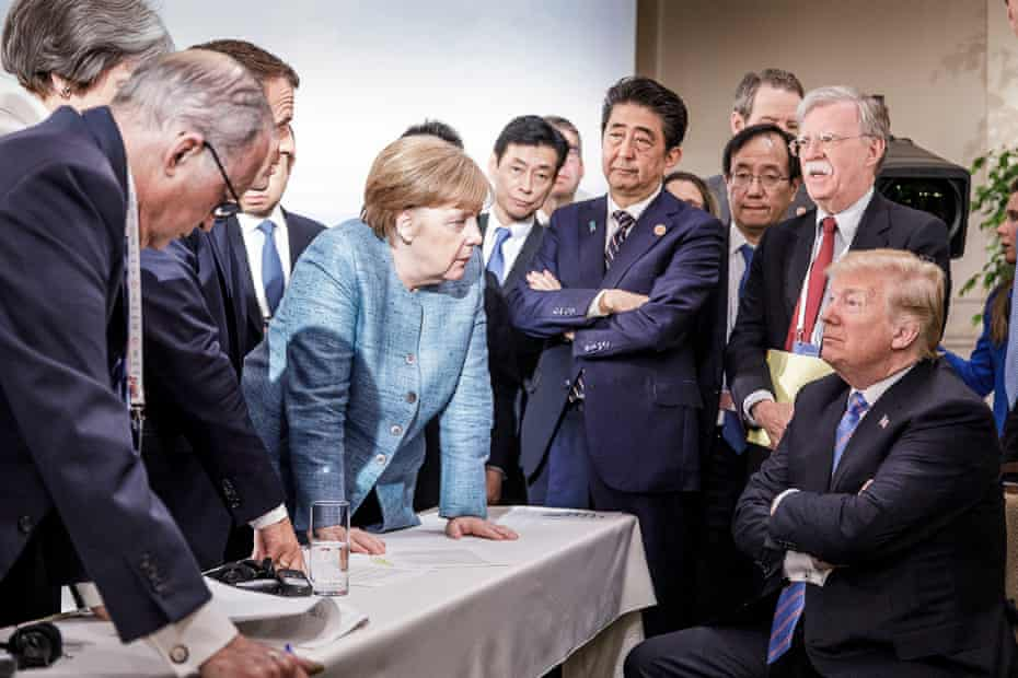Angela Merkel deliberates with Donald Trump on the sidelines of the official agenda at the G7 summit on in Charlevoix, Canada