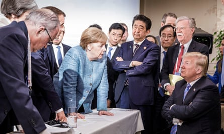 Donald Trump listens to other leaders make a point during the G7 meeting in Canada in June 2019.