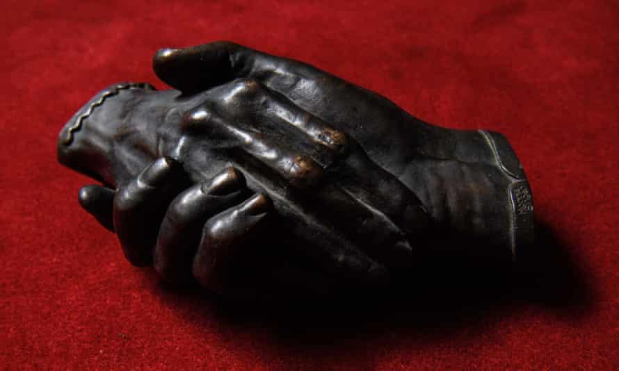 a bronze cast of the Clasped Hands of Robert and Elizabeth Barrett Browning by Harriet Goodhue Hosmer.