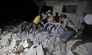 Rescuers sift through rubble following an airstrike