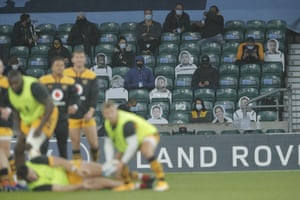 The Wasps payers warm up in front of a mixture of humans and cardboard cutouts.