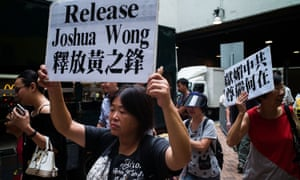 Protesters march to the Royal Thai Consulate-General in Hong Kong after Joshua Wong was detained.
