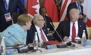 Donald Trump with Angela Merkel and Tunisian president Beji Caid Essebsi at the G7 summit. Merkel said: 'The whole discussion about climate has been difficult, or rather very unsatisfactory.'