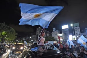 Supporters of Mauricio Macri, the Conservative opposition candidate, celebrate in the streets in Buenos Aires, Argentina, after his election victory