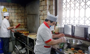Chefs wearing masks to protect themselves from coronavirus.