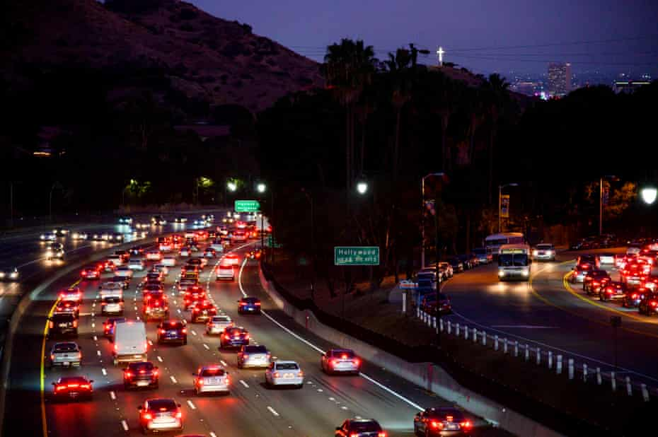 Motor vehicles drive on the 101 freeway in Los Angeles, California. Critics say the move will lead to more life-threatening air pollution and force Americans to spend more on gasoline.