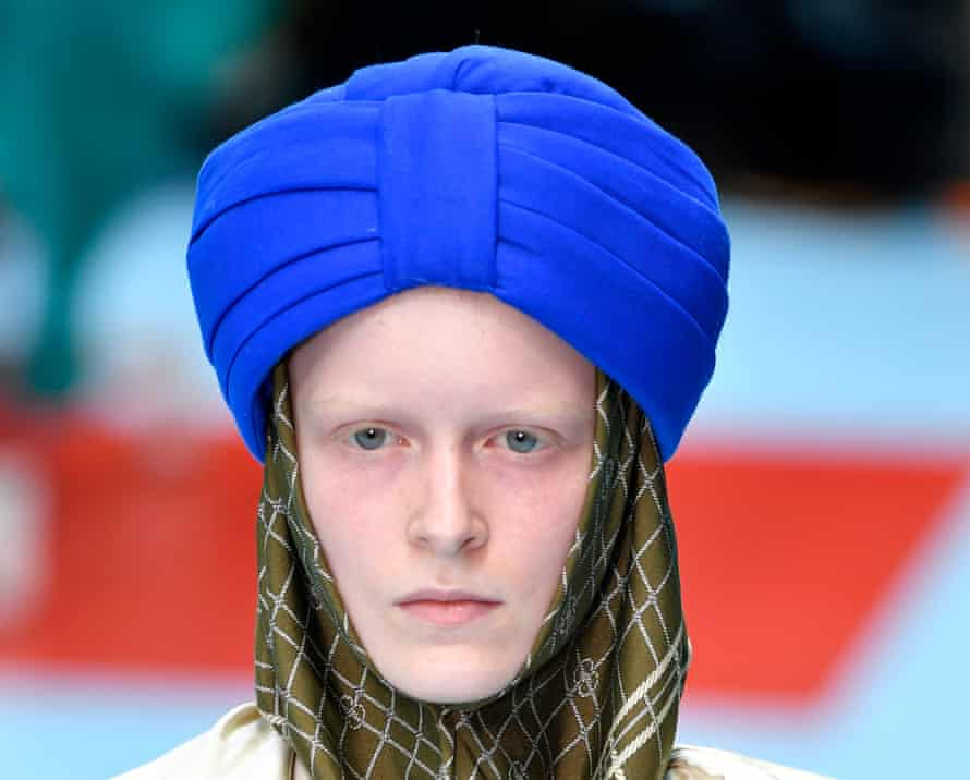 A model wearing a Gucci turban-style hat