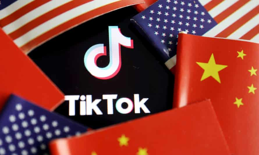 China and US flags are seen near a TikTok logo.