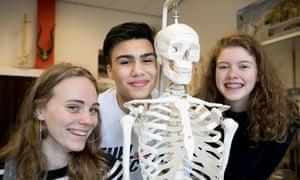 Yara Agterhof, left, Saffron Jones, right, and Dani Karremans at school in the Netherlands