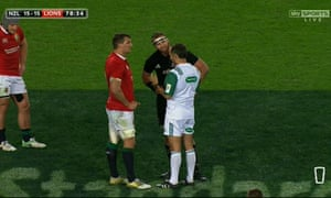 Sam Warburton, the Lions captain, and his All Blacks counterpart, Kieran Read, listen as Romain Poite explains the decision of accidental offside late in the third Test in Auckland.