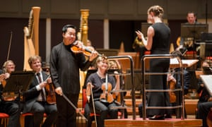 CBSO Mirga Grazinyte-Tyla and Ning FengViolinist Ning Feng and CBSO conductor Mirga Grazinyte-Tyla take the applause at the end of Bruch's Scottish Fantasy at Symphony Hall, Birmingham.