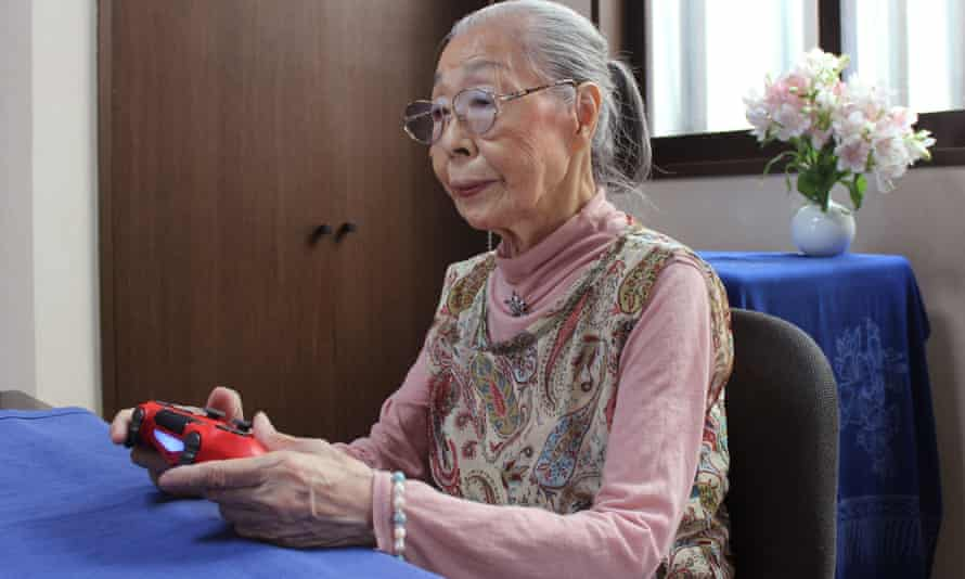 Hamako Mori holds a gaming console