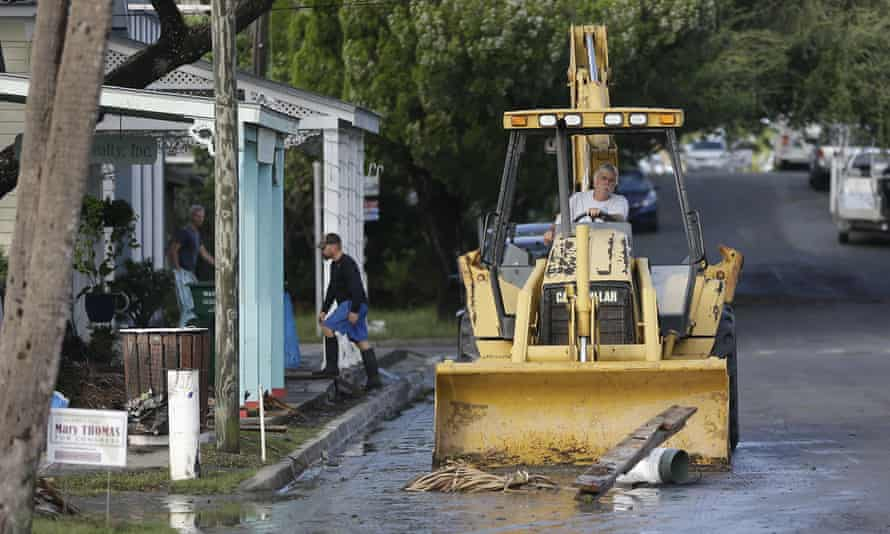 A front end loader clears debris from the street after Hurricane Hermine passed through on Friday.