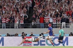 Japan's Pieter Labuschagne scores their third try.